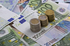 Euro banknotes money. Euro money banknotes of hundreds, twenty, fifty mixed and euro  coins related to crisis Stock Images