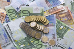Euro banknotes money. Euro money banknotes of hundreds, twenty, fifty mixed and euro coins related to crisis Stock Photo