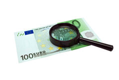 Euro banknotes money and magnifying glass Royalty Free Stock Images