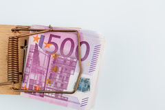 Euro banknotes in mouse trap. Many euro banknotes in a mousetrap. photo icon for debt and debt in loans Stock Photo