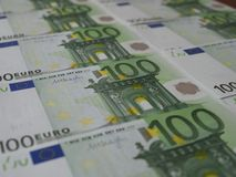 100 Euro banknotes are neatly arranged in rows royalty free stock images