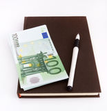 Euro banknotes, notebook and pen Stock Photos