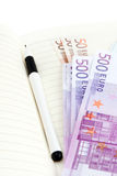 Euro banknotes, notebook and pen Royalty Free Stock Photos