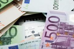 Euro Banknotes Over Electricity Meter Stock Photo