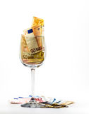 Euro banknotes. Paper euro banknotes in a glass on a white background Royalty Free Stock Photography