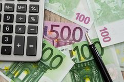 500, 100 euro banknotes and part of a calculator, close-up. 500, 100 euro banknotes and part of a calculator royalty free stock photos