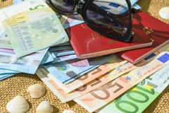 Euro banknotes, passports and shells on a linen background. the concept of travel Royalty Free Stock Photos
