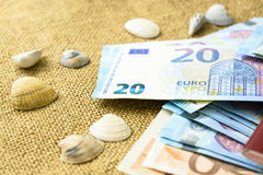 Euro banknotes, passports and shells on a linen background. the concept of travel Stock Image