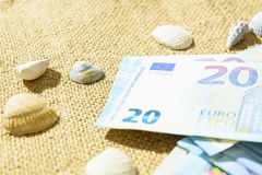 Euro banknotes, passports and shells on a linen background. the concept of travel Royalty Free Stock Image