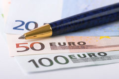 Euro banknotes and pen Royalty Free Stock Photography