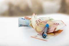 Euro banknotes and a pen Stock Photos