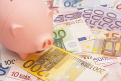 Euro banknotes and piggy bank Stock Images