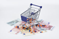 Euro banknotes and pills Royalty Free Stock Images