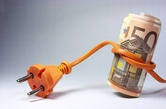 Euro banknotes and plug Stock Images