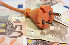 Euro banknotes and plug Royalty Free Stock Photography