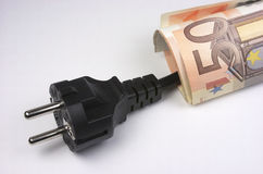 Euro banknotes and plug Royalty Free Stock Images