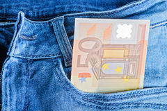 50 Euro banknotes in a pocket. 50 Euro banknotes in a blue jeans pocket Stock Photo
