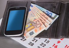 Euro banknotes purse calendar Stock Photos