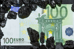 Euro banknotes on raw coal nuggets, bills on coal, power of money and ore stock images