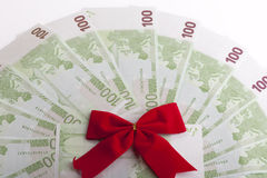 Euro banknotes with red ribbon. Red ribon on one hundred Euro banknotes, isolated on white Stock Photo
