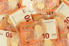 10 euro banknotes scattered closeup. Scattered euro currency banknotes closeup Stock Photo