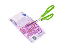Euro banknotes and scissors stock images