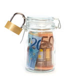 Euro banknotes in sealed jar with padlock Stock Photo
