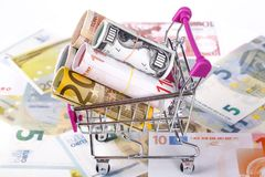 Euro Banknotes with Shopping Cart Consuming Concept Stock Photos