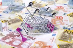Euro Banknotes with Shopping Cart Consuming Concept Stock Photo