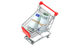 Euro banknotes in a shopping trolley cart. Rolls of Euro banknotes in a shopping trolley cart - studio shot with a white background Stock Photo