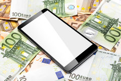 Euro banknotes and smart phone. Royalty Free Stock Photos