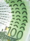 Euro banknotes. Some 100 euro banknotes are spread Stock Image