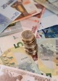 Euro banknotes and stack of coins isolated Stock Photography