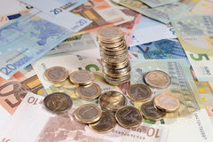 Euro banknotes and stack of coins isolated Stock Image