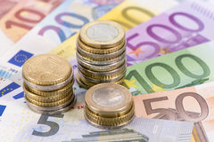 Euro banknotes with stacked coins Stock Photos
