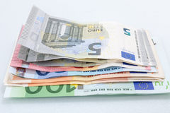 Euro banknotes stacked by value. Several hundred euro banknotes stacked by value. Euro money concept Royalty Free Stock Photography