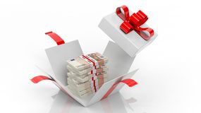 50 euro banknotes stacks in opened giftbox with red ribbon Royalty Free Stock Image