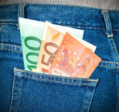 Euro banknotes sticking out of the back jeans pocket Royalty Free Stock Image