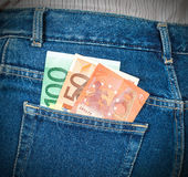 Euro banknotes sticking out of the back jeans pocket Stock Images