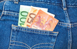 Euro banknotes sticking out of the blue jeans pocket Stock Photography