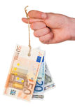 Euro banknotes tag on thumb Royalty Free Stock Image