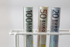 Euro banknotes in Test tubes Royalty Free Stock Photo