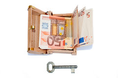 Euro banknotes in the treasure chest and old key Royalty Free Stock Photos