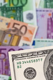 Euro banknotes and U.S. dollars. Royalty Free Stock Images