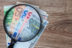 Euro banknotes under looking glass Stock Images