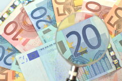 Euro banknotes under magnifying glass Royalty Free Stock Image
