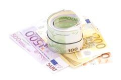 Euro banknotes under rubber band Stock Photos