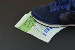 Euro banknotes under shoes Stock Photography