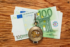 Euro banknotes and vintage pocket watch Stock Photos