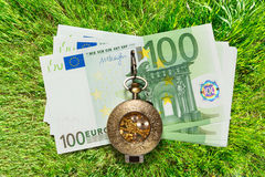 Euro banknotes and vintage pocket watch Royalty Free Stock Image